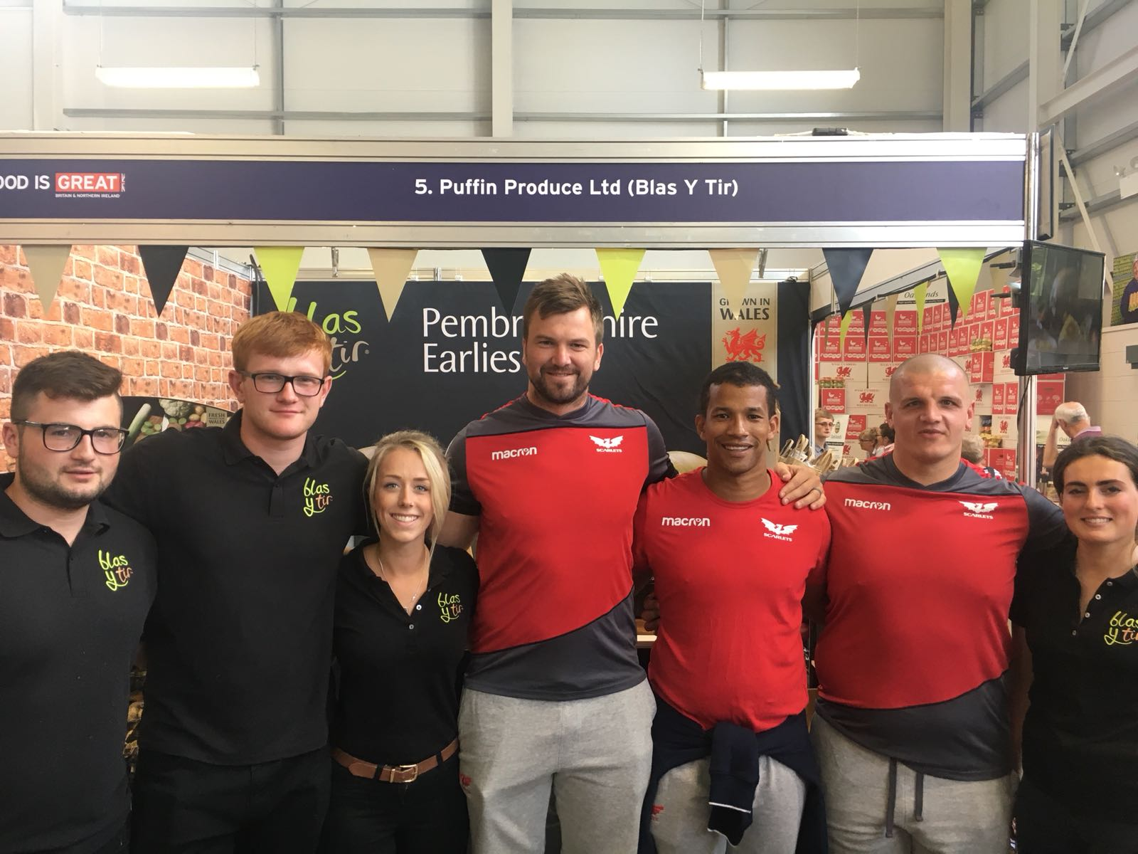 Scarlets Rugby Team visiting the Blas y Tir stand at the Royal Welsh Show 2018