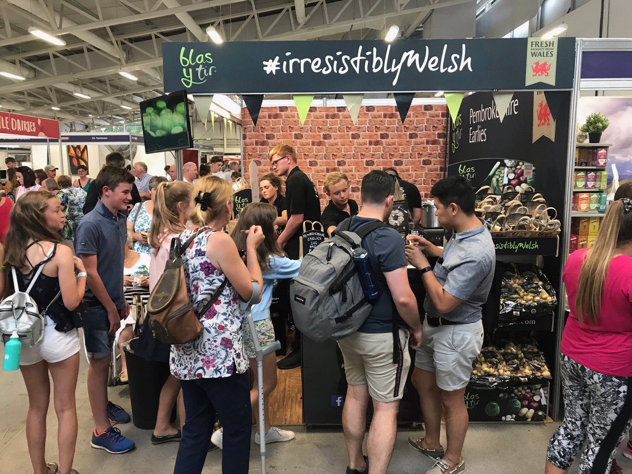 Visitors at the Blas y Tir Stand at the Royal Welsh Show 2018